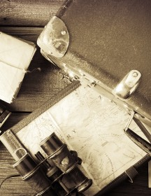 old traveling equipment: camera, binoculars, mapholder and map with vignette